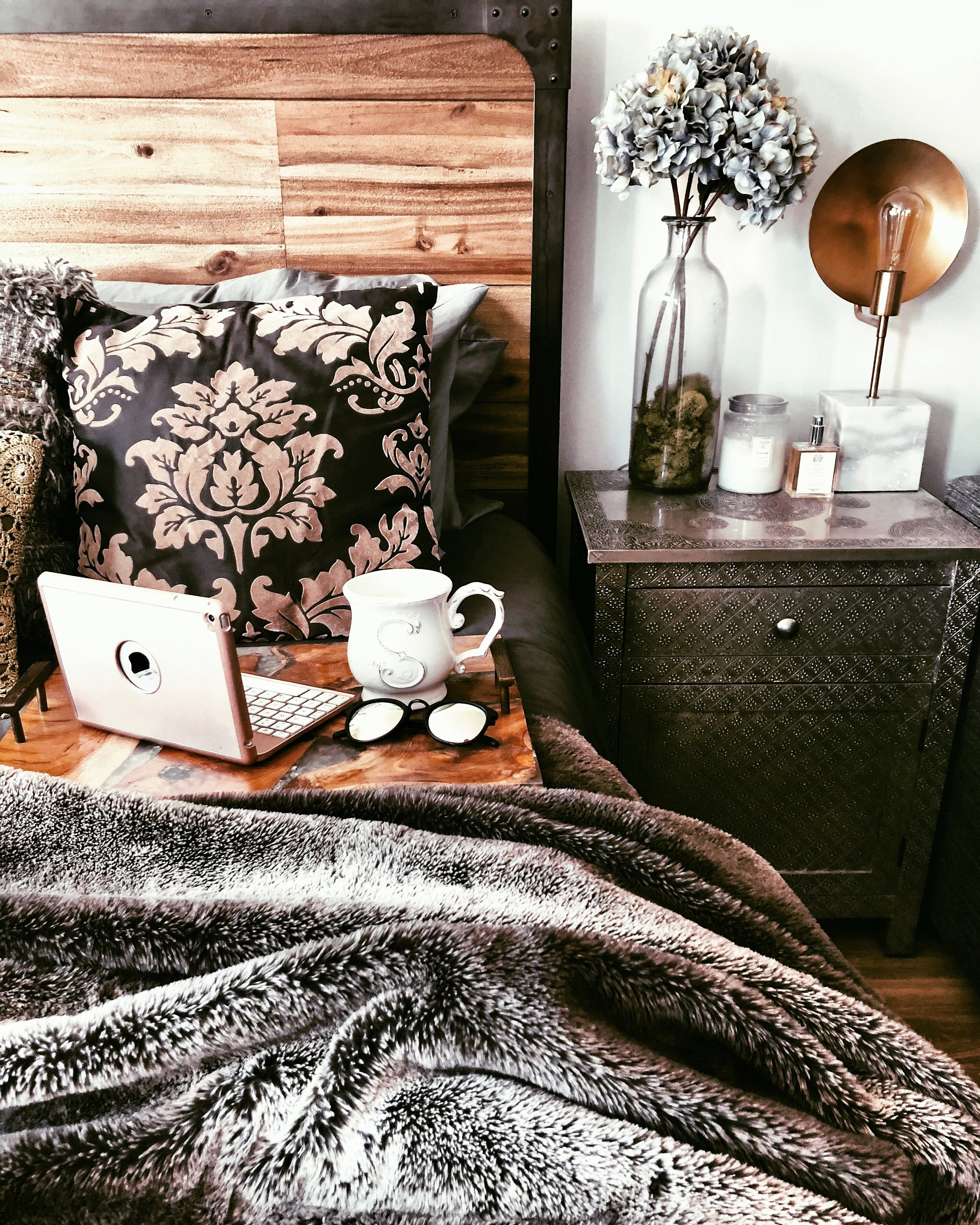 Cozy bedroom decor with rustic interior styling.