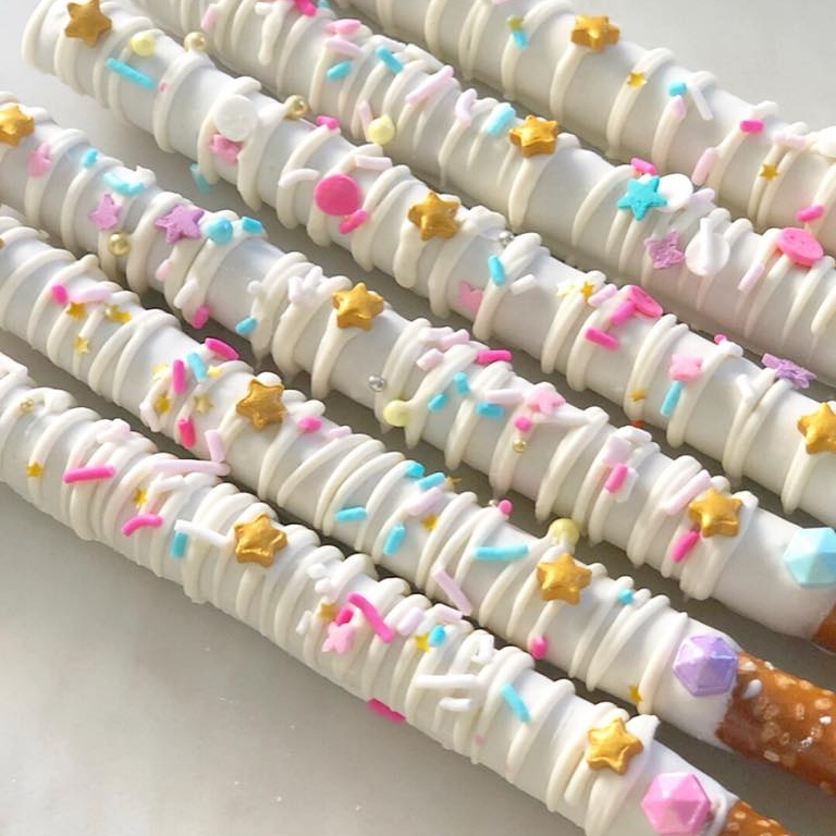 CHOCOLATE COVERED PRETZELS - Kid and adult friendly! These pretzel rods dipped in chocolate, drizzled with chocolate and decorated with various sprinkles.