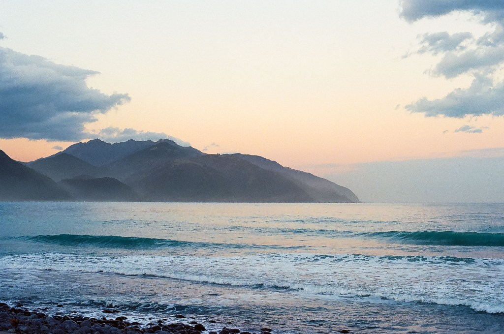 Sunset off the coast of Half Moon Bay, New Zealand South Island