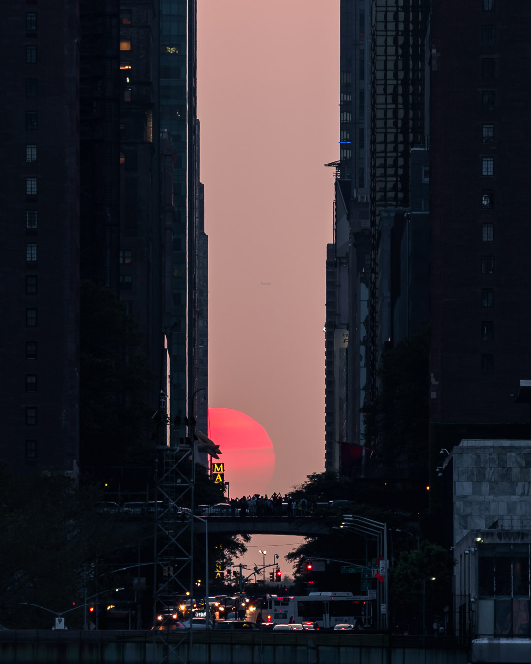 Photo captured by  Mike Lindle  during the  May 31st, 2019  Manhattanhenge from Gantry Plaza State Park, Long Island City. As the sun dipped further below the horizon, clouds blocked the full disc of the setting sun.