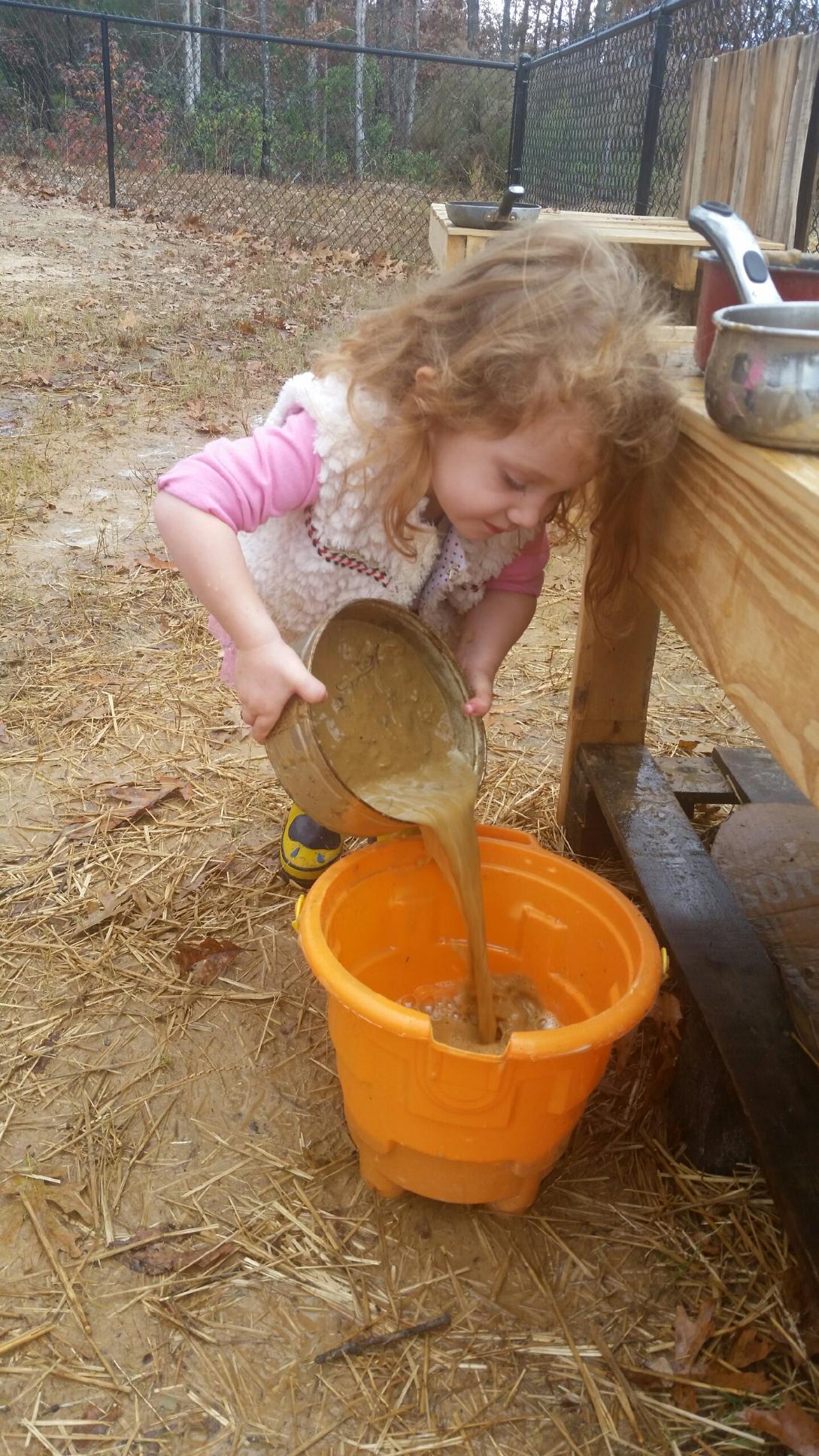 Kinley pouring mud.jpg