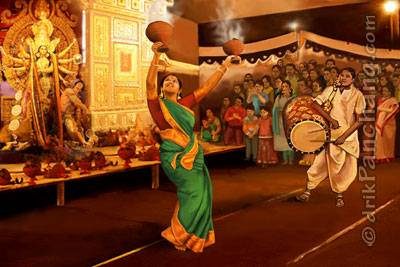 "The tradition Dhununchi dance of Bengal on the beats of ""Dhaak"" drum   Image Credits: Drikpanchang"