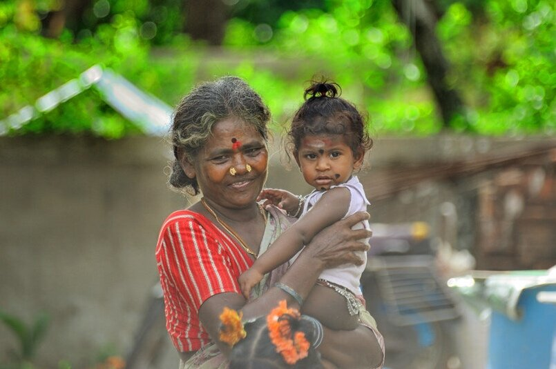 A grandmother with granddaughter, India.  Image Credits :  Nithi Anand, Flickr