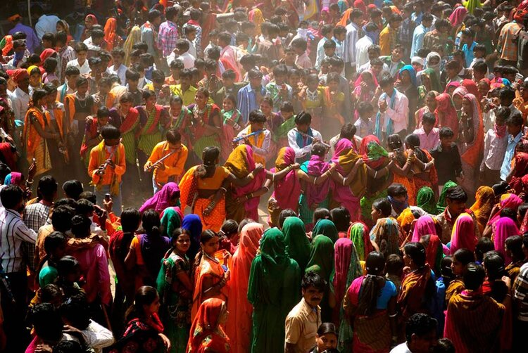 Tribals in Bakhatgarh village dancing during the colourful Bhagoria festival, which celebrates the  kharif  harvest just prior to Holi in spring | Source:    RuralIndiaOnline
