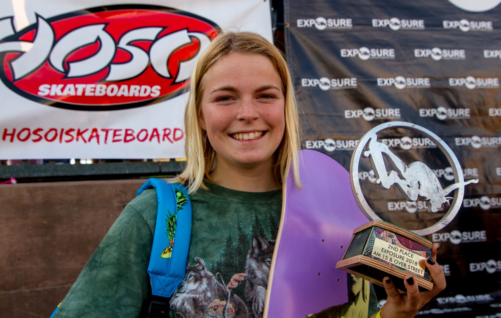 Carly Vanderkarr is stoked on her win and rad recycled skateboard trophy.  Photo credit for this photo and above are courtesy  Lauren Verner Creative .