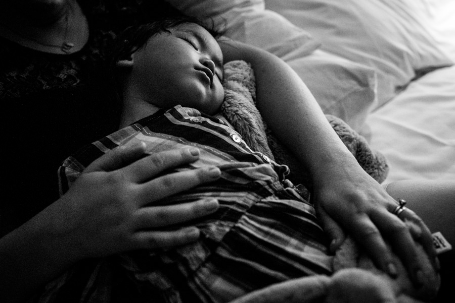 daughter asleep in her mother's arms