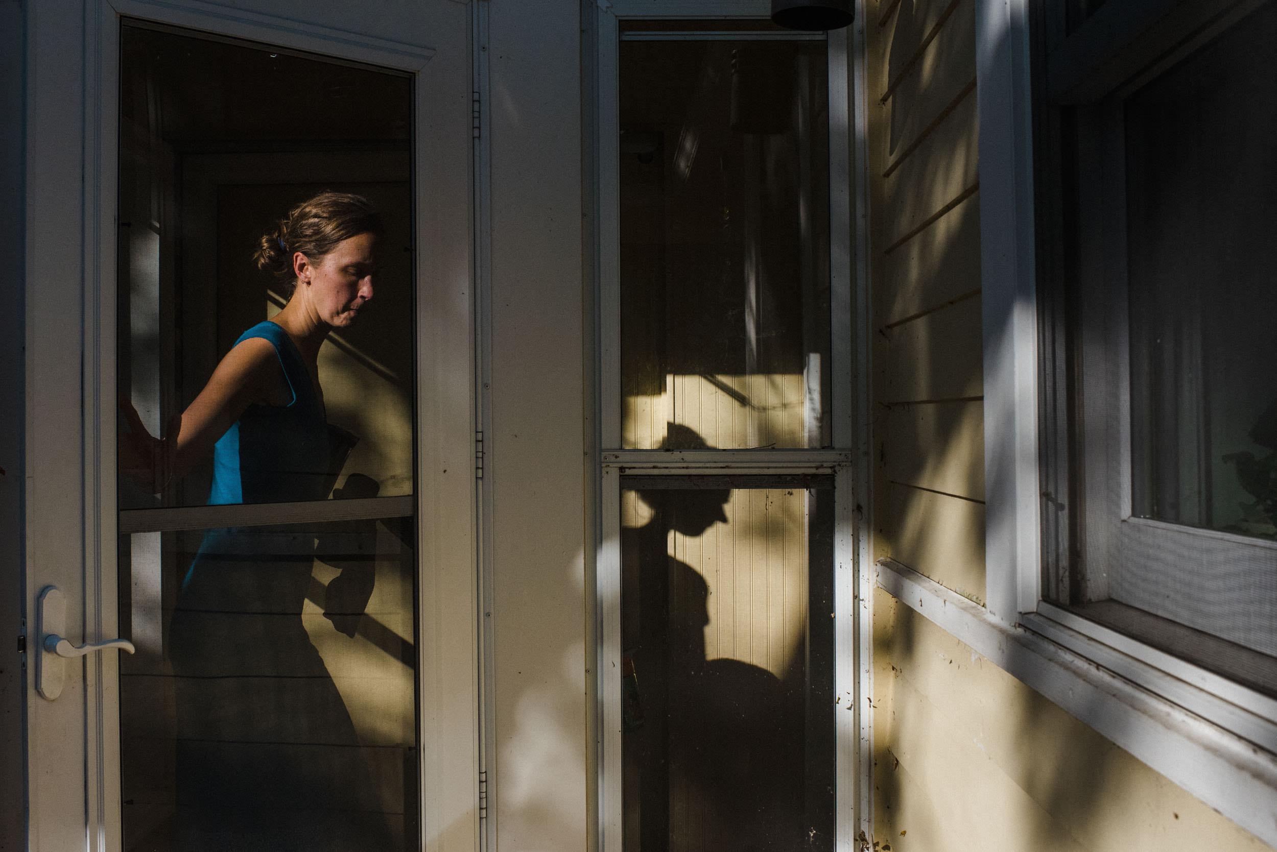mom entering the house through the backdoor