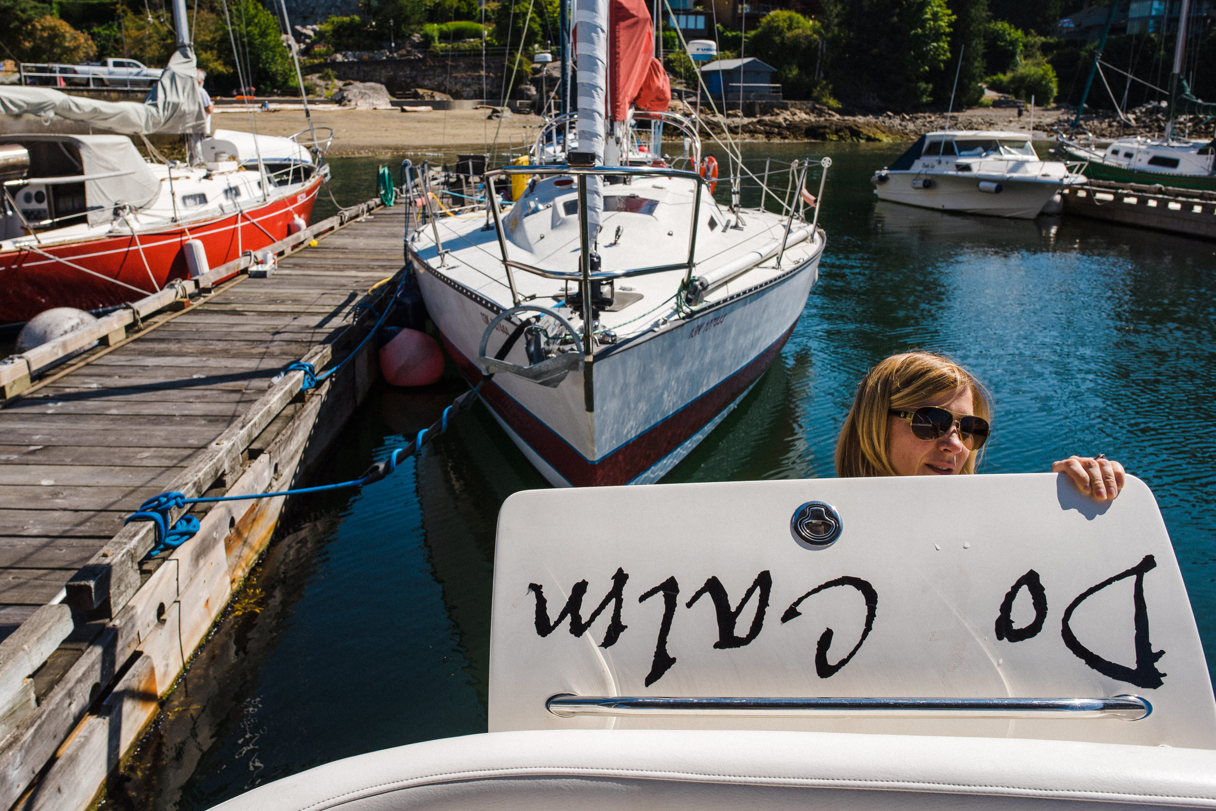 woman preparing boat for launch at dock