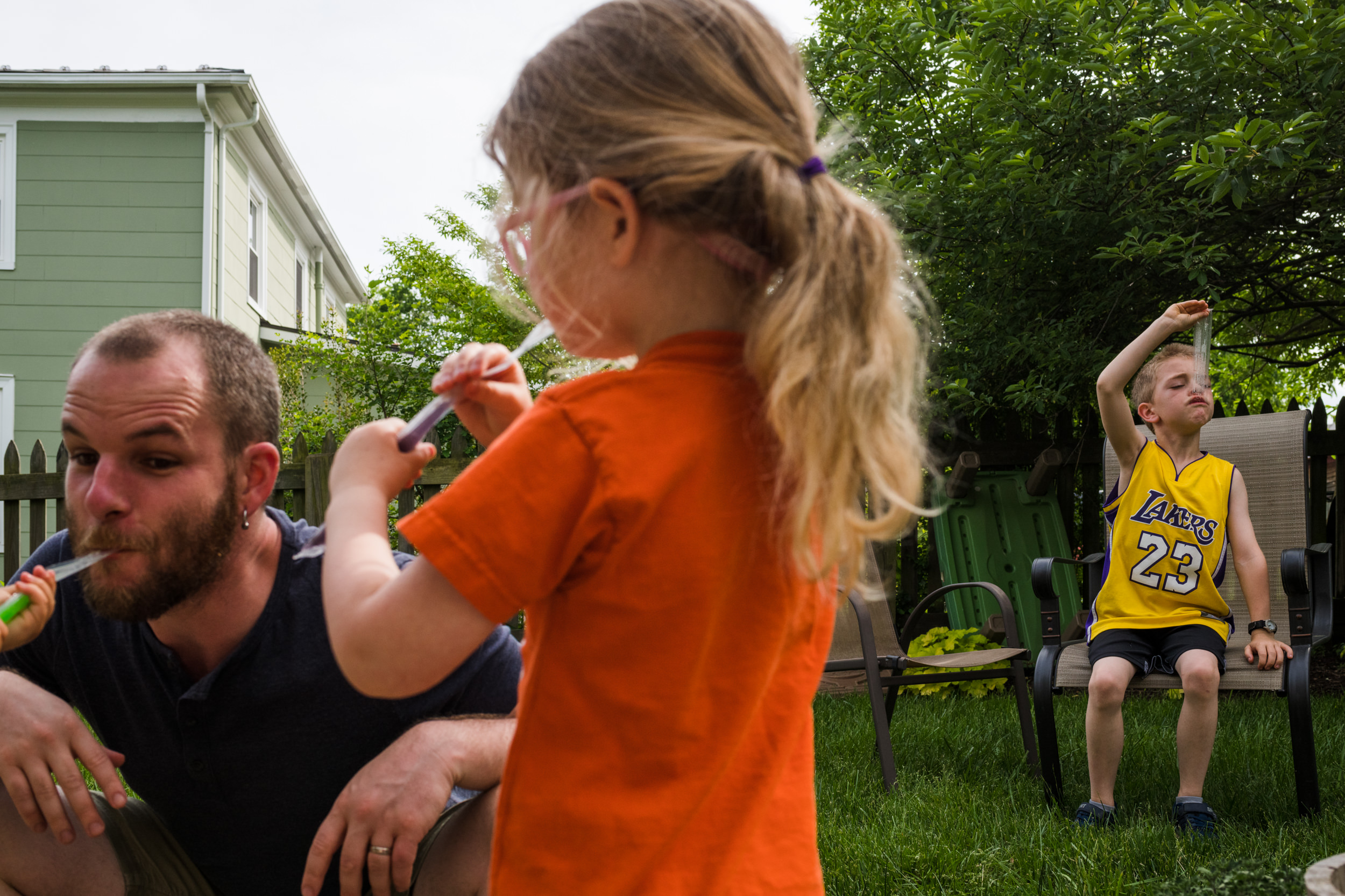 Family enjoying freezies together in their backyard.