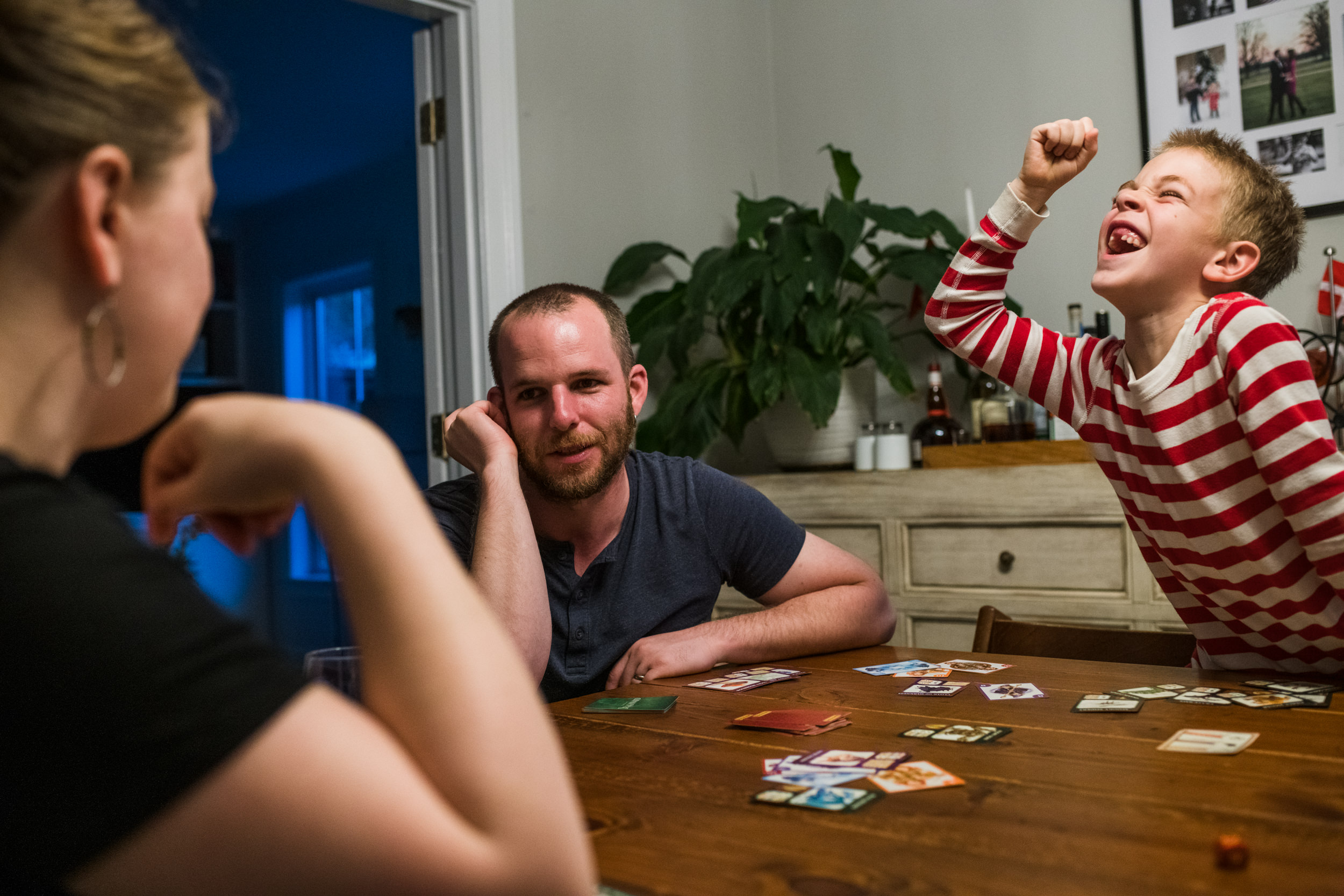 Parents are enjoying some one-on-one time playing a game with their son.