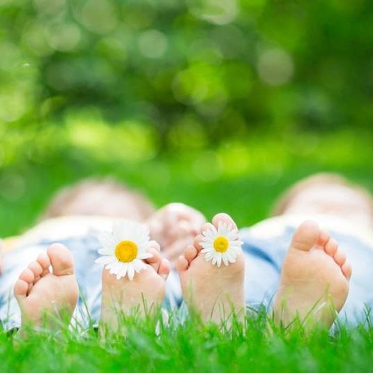 Children lying in grass.jpg