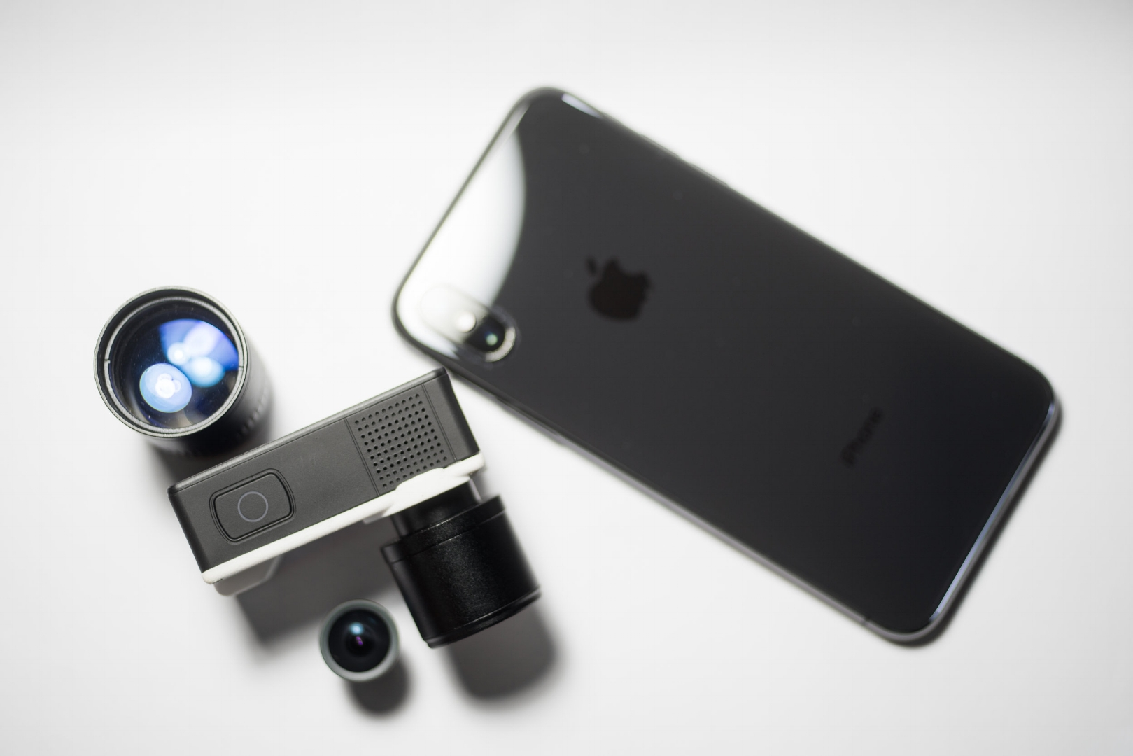 NANO1 with assorted lenses with Apple iPhone X (TM) for size comparison