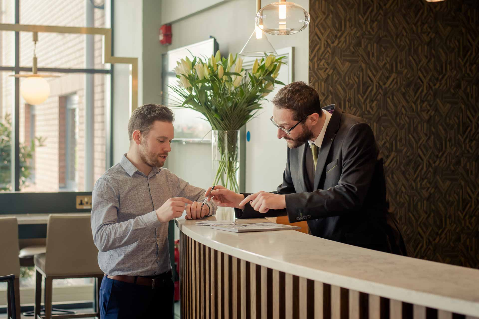 The Hoban Hotel Kilkenny man checking into hotel.JPG