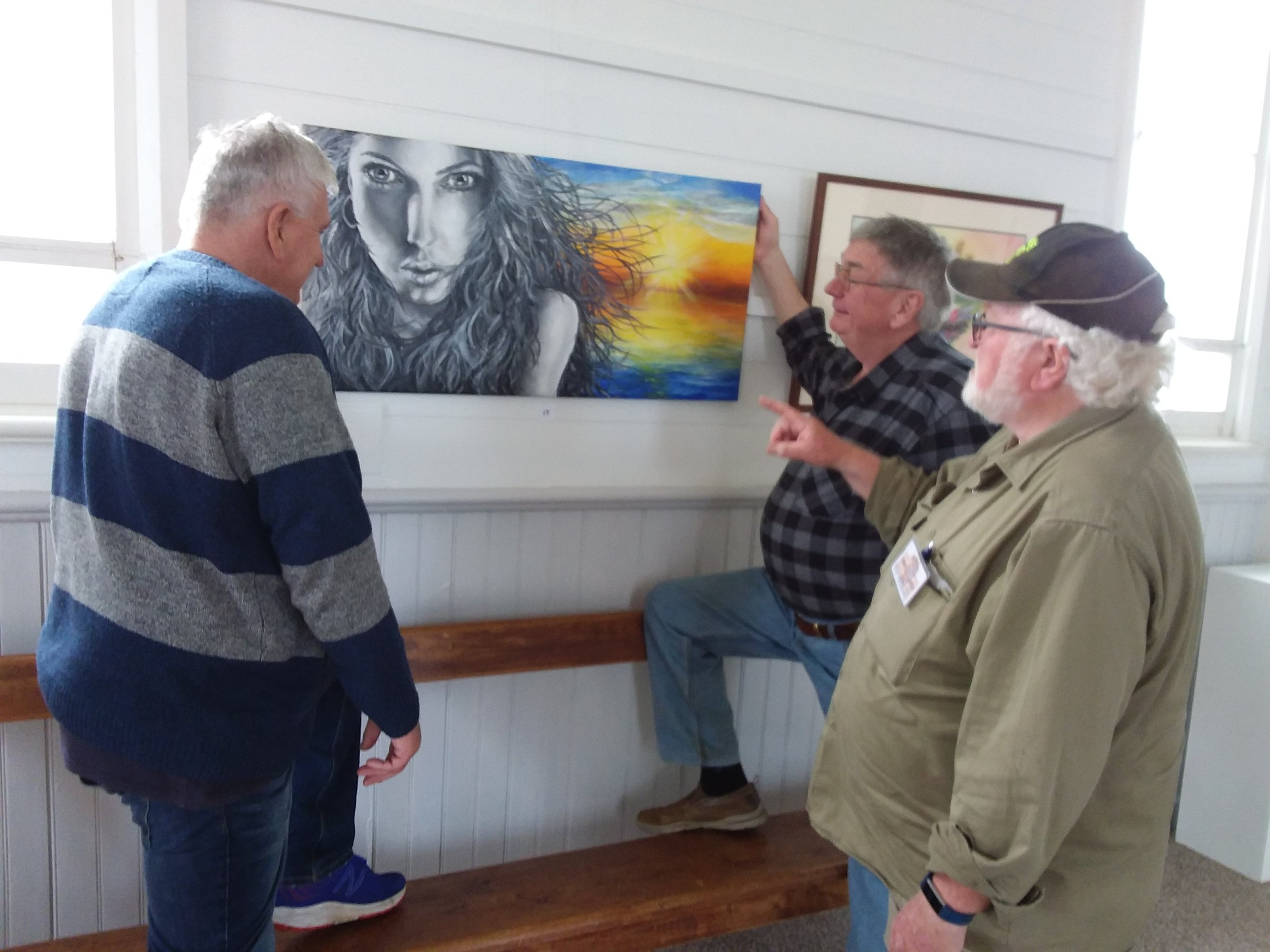 JOHN, RODNEY AND GEOFF FROM THE BURNIE AND SOMERSET MENS SHED HELPED HANG UPTOWN ART