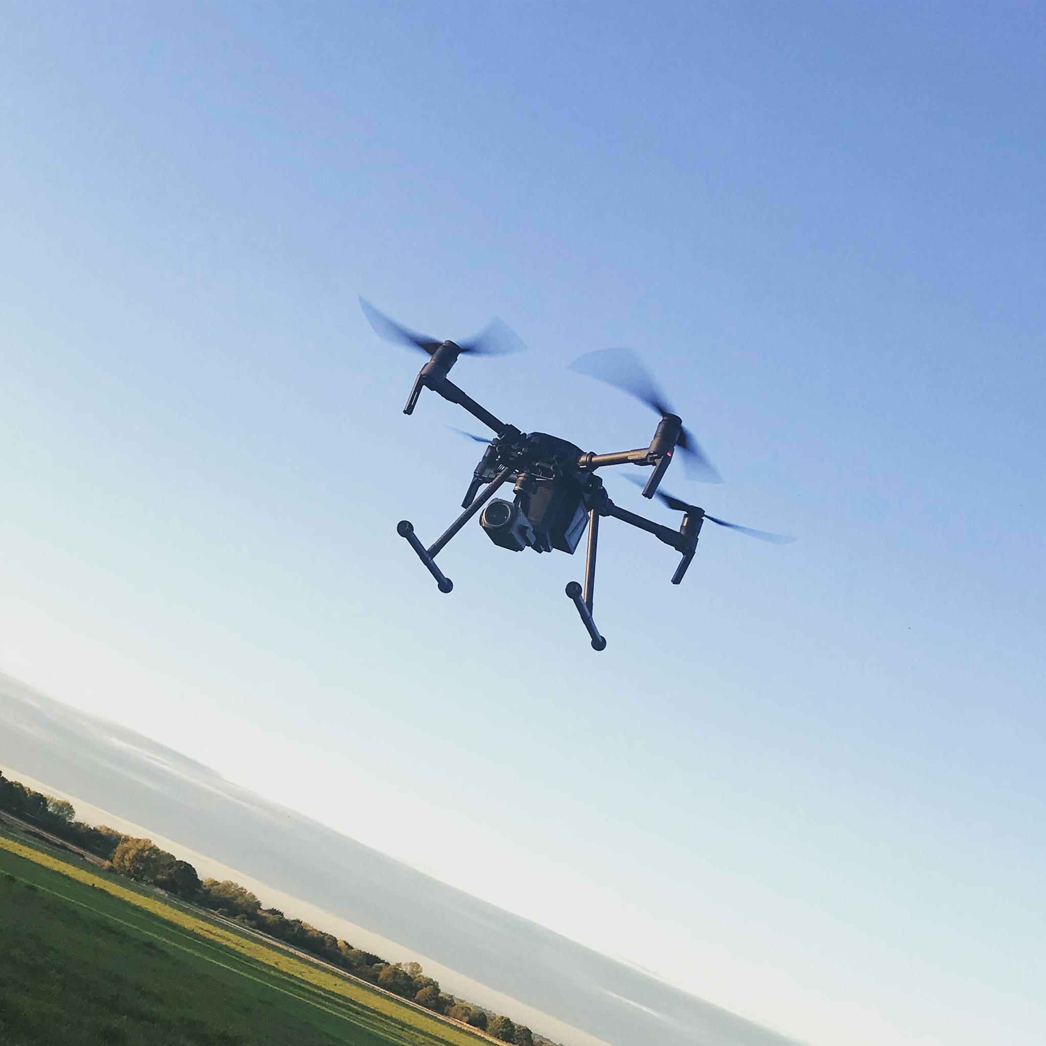 DJI m210 in flight.jpeg