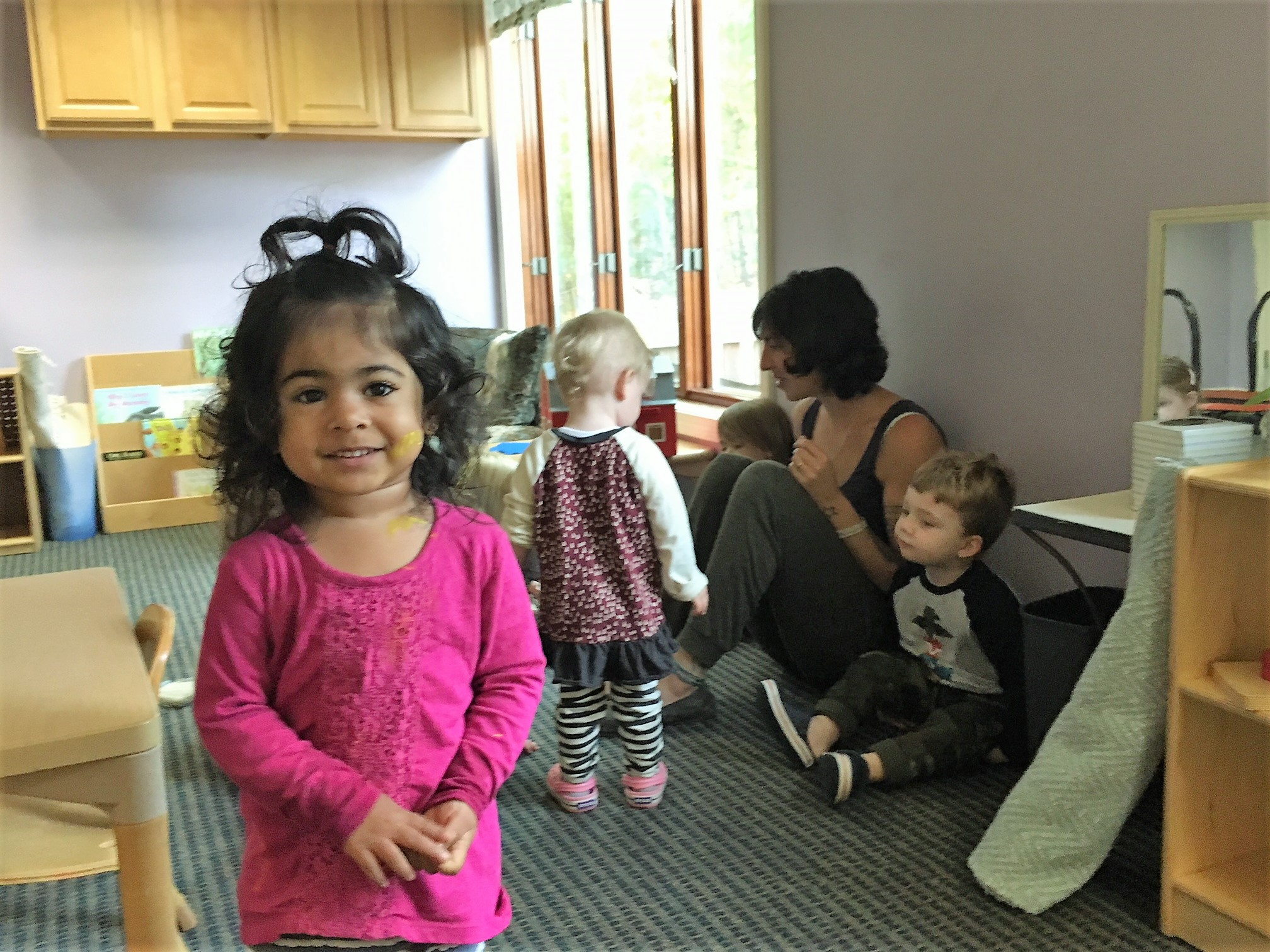 Smiles in the toddler classroom.
