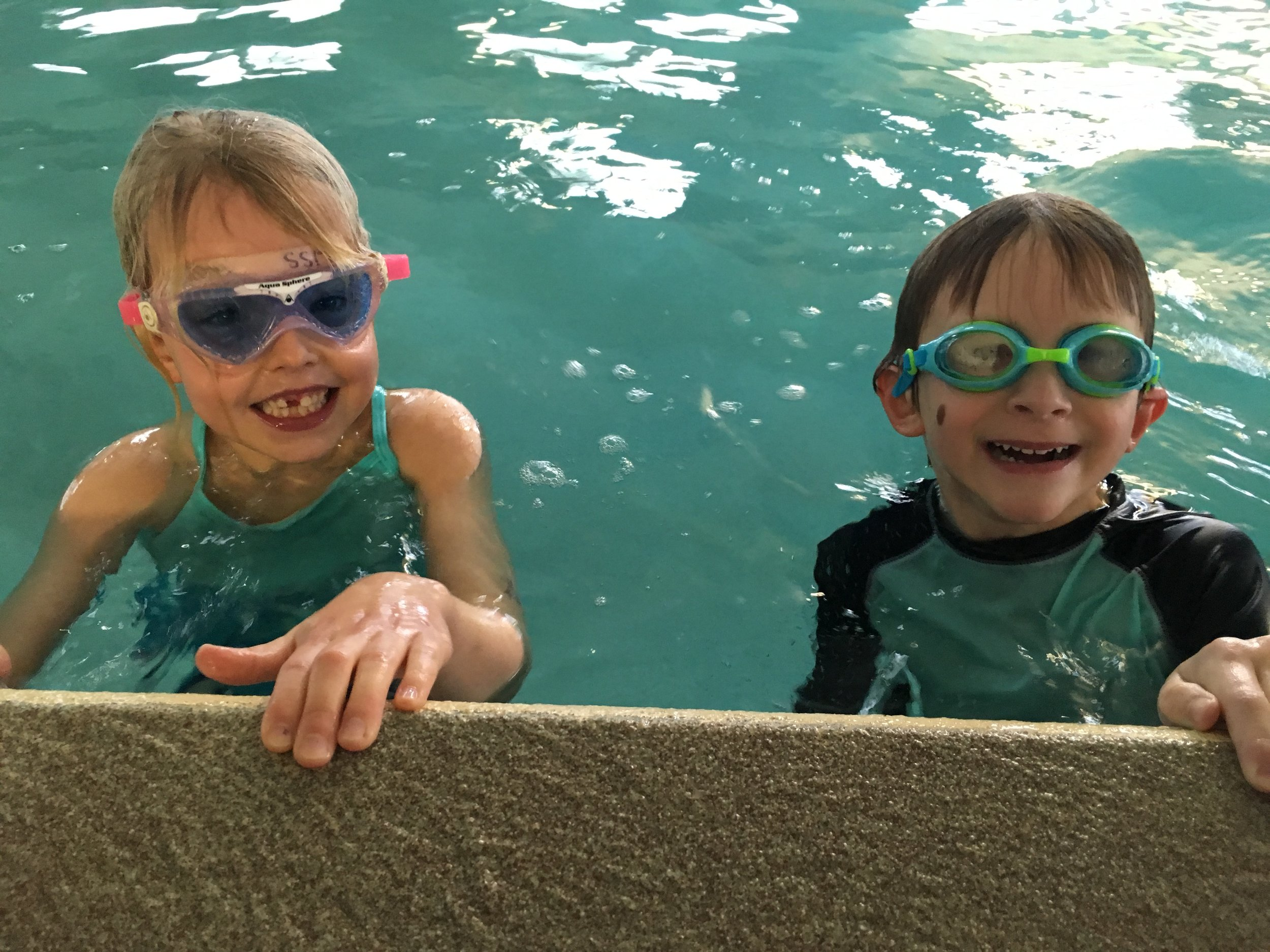 These two lower elementary students are enjoying their swim lessons after walking to the pool from school as part of their winter fitness program.