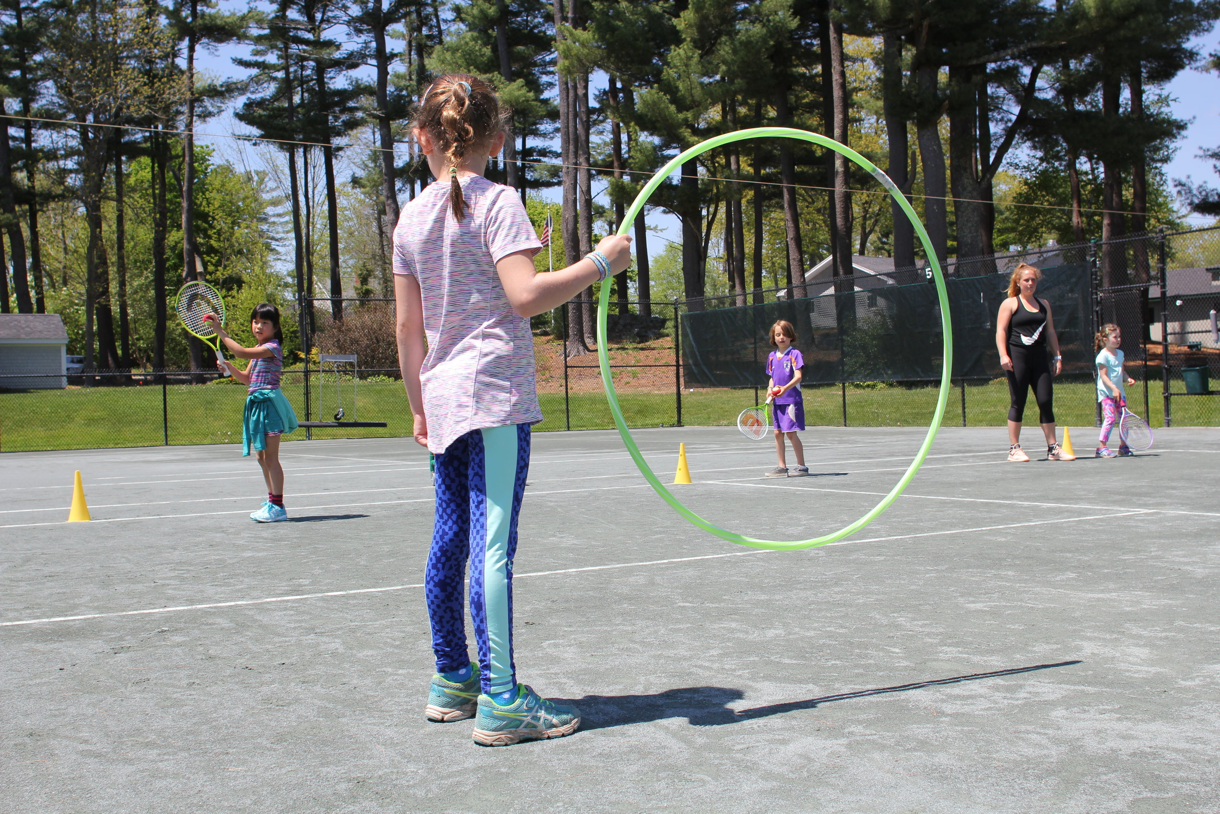 Elementary students take the bus to York Golf & Tennis for tennis lesson in the  spring and fall as part of their physical fitness curriculum.
