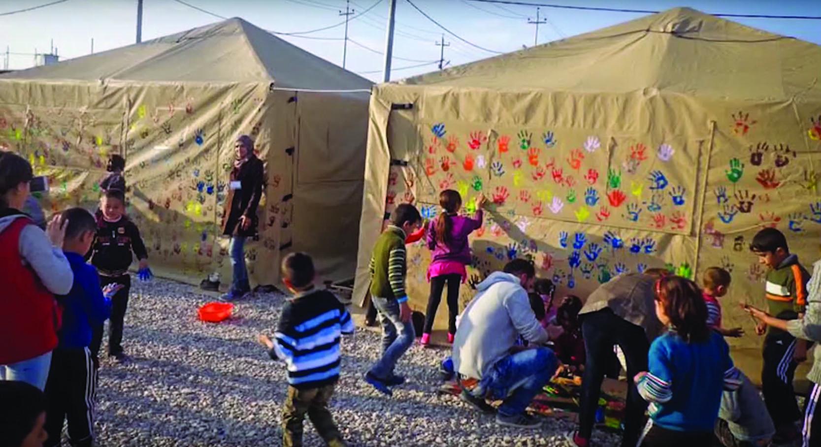 ht-tent-iraq-kids-handprints.jpg