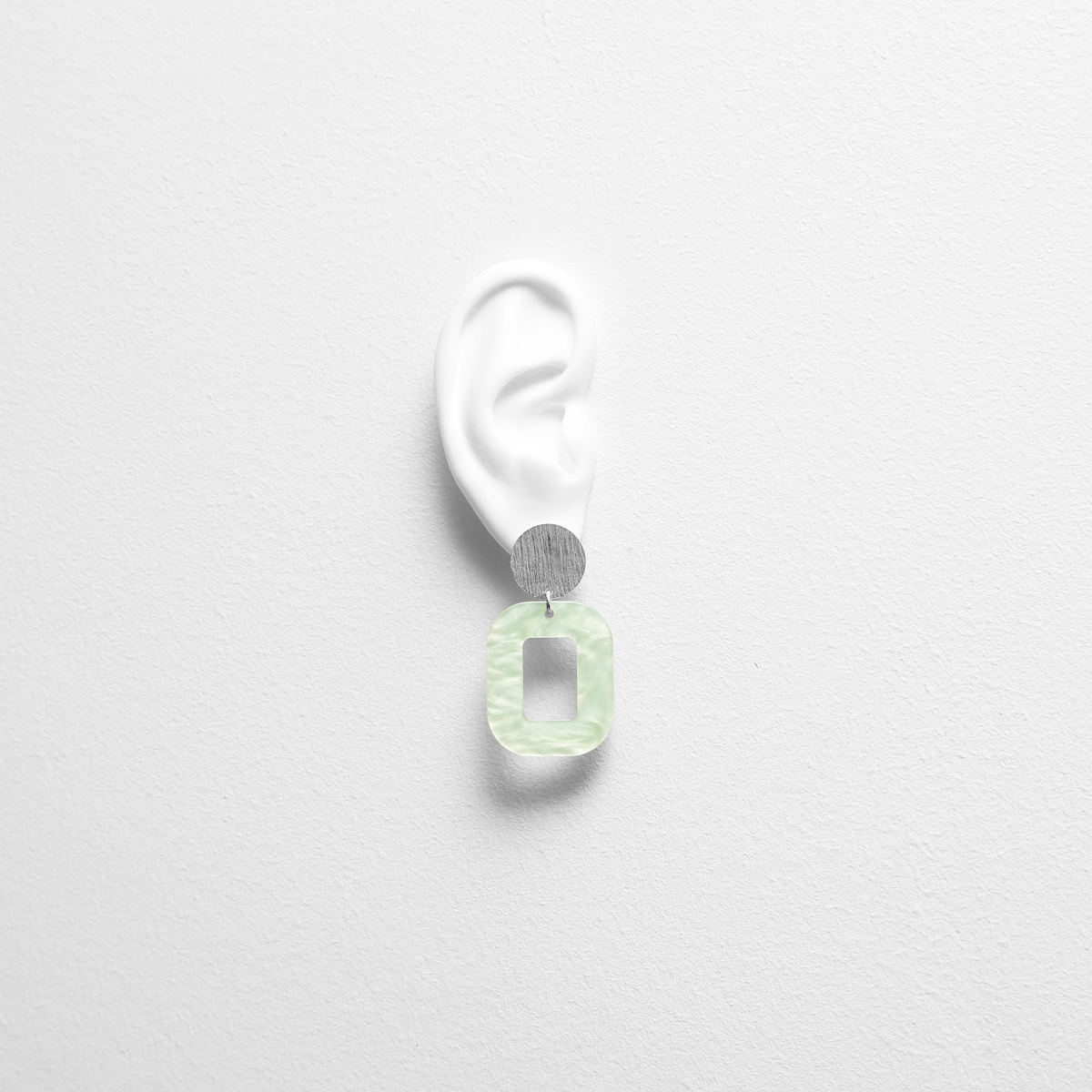 pastel-green-baby-rosa-earrings-try-on.png