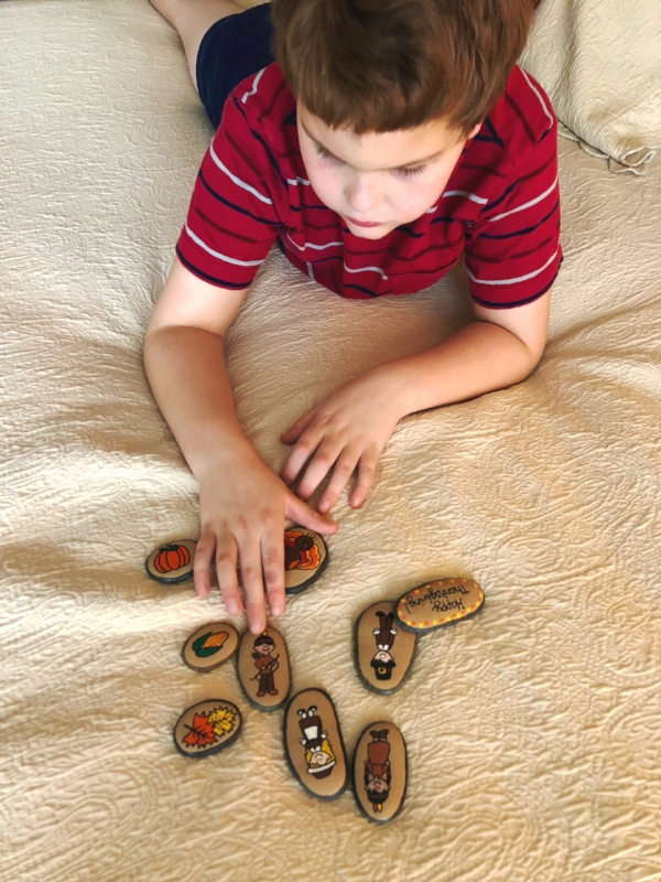 My son, Peter, playing with the Thanksgiving Story Stones. He has autism and lots of sensory issues, and he enjoys handling the stones.