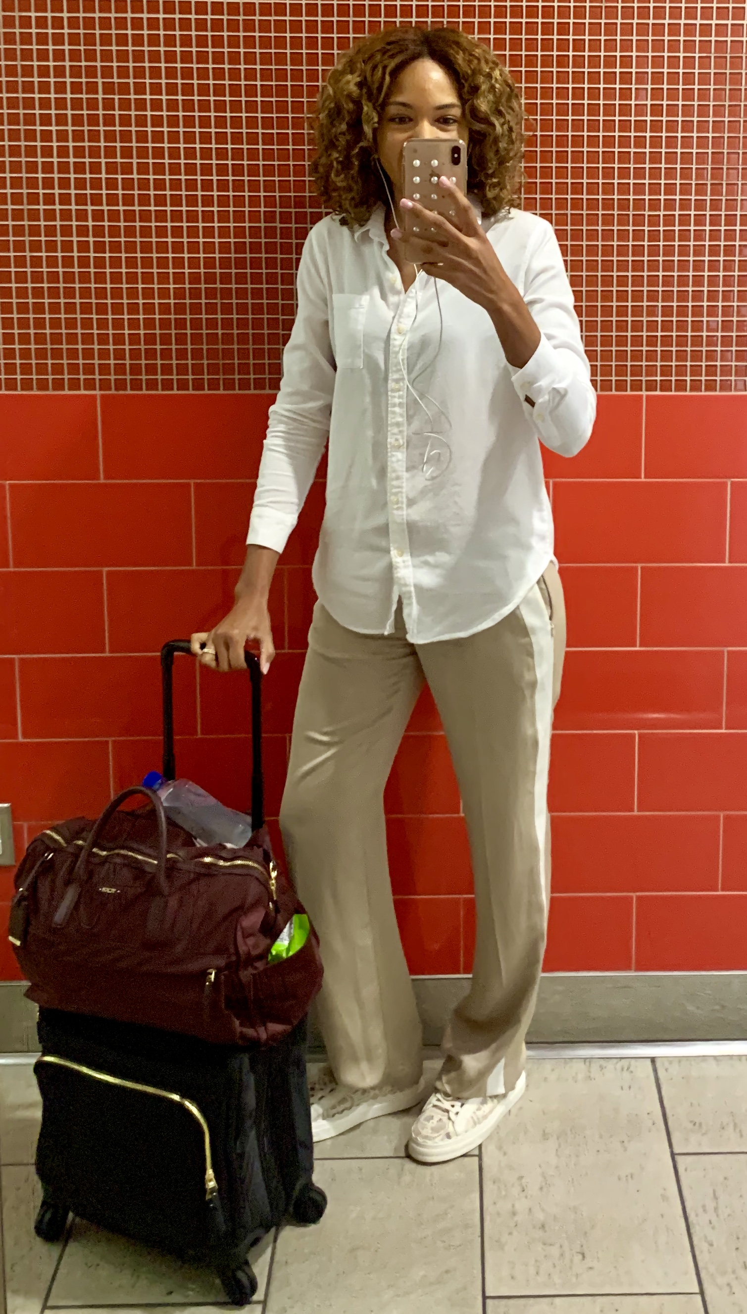 - Track Pants by Theory - linked: hereShoes from Chloe - linked: hereLuggage Tumi - Voyageaur Osona Carry-on : here and Voyageur Sheryl Business Tote - here