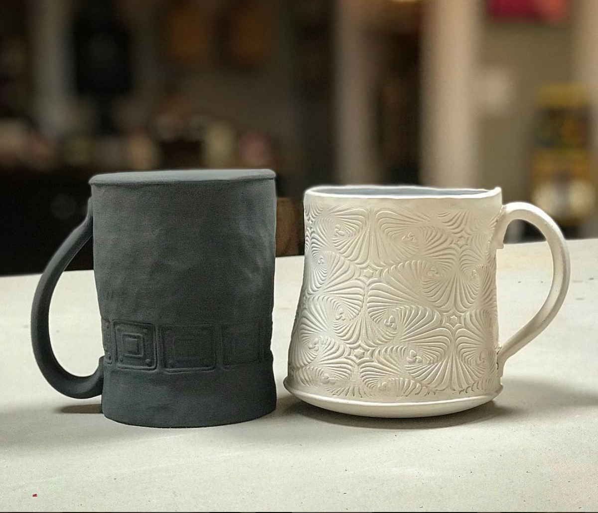 Handbuilt mugs in process. Students can learn many different techniques in class.