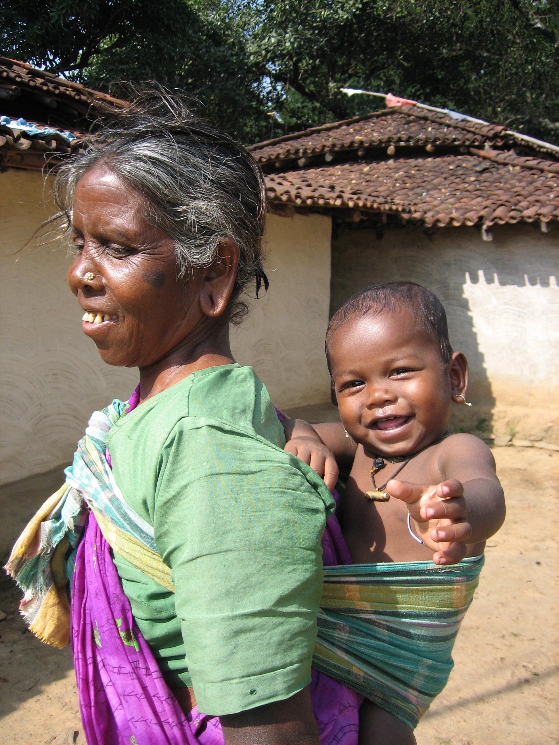 C6 Munda Adivasi grandmother carrying her grandson.jpg