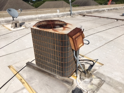 Rusted A/C Unit on Rooftop in College Station