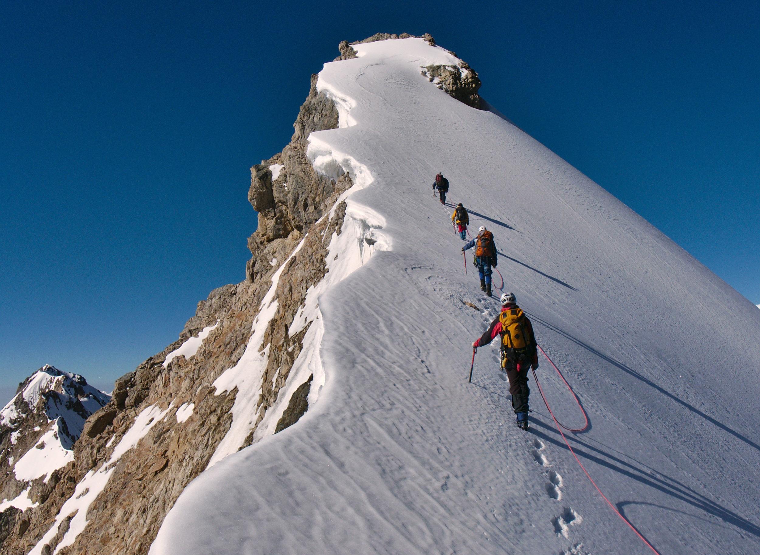 Team hiking snow