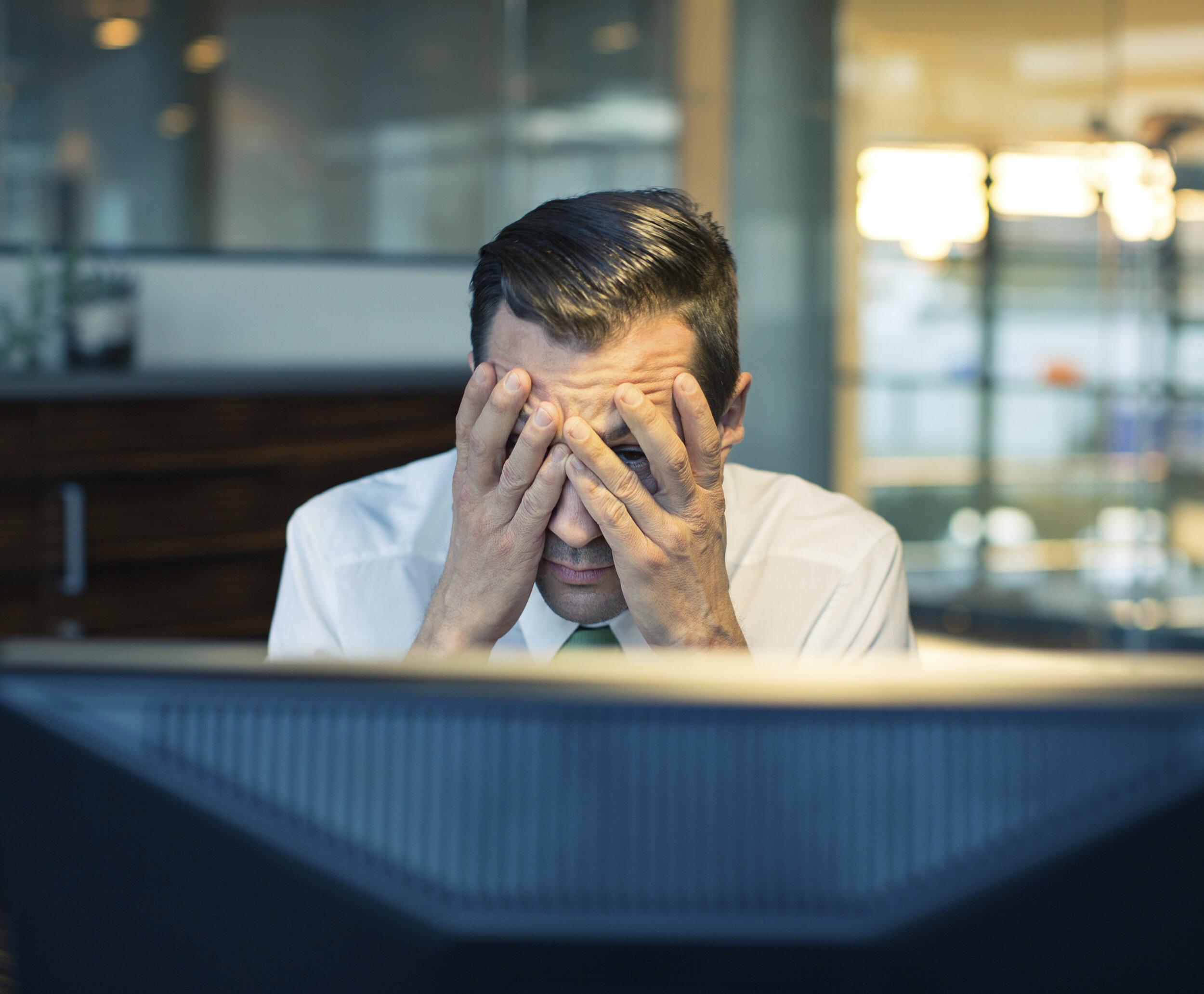 Man frustrated at computer
