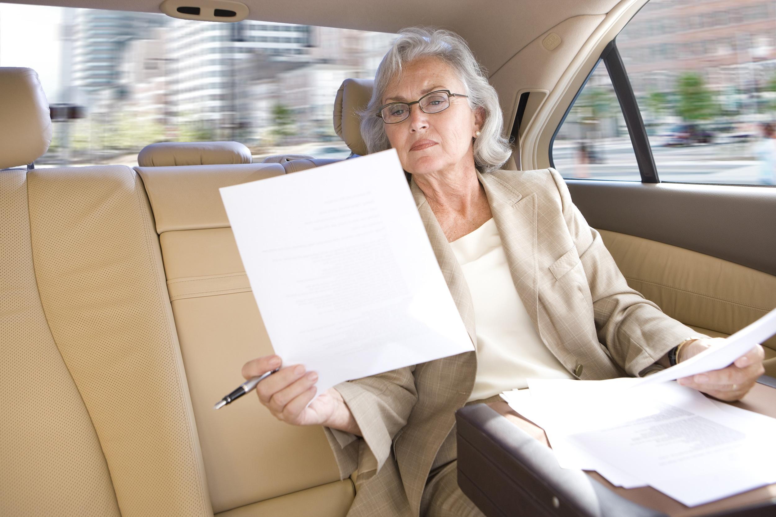 Executive in car reading