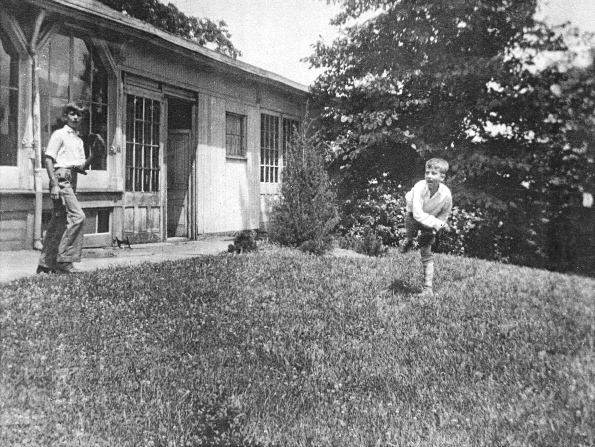 Children playing on the lawn near the Devou home c. 1920