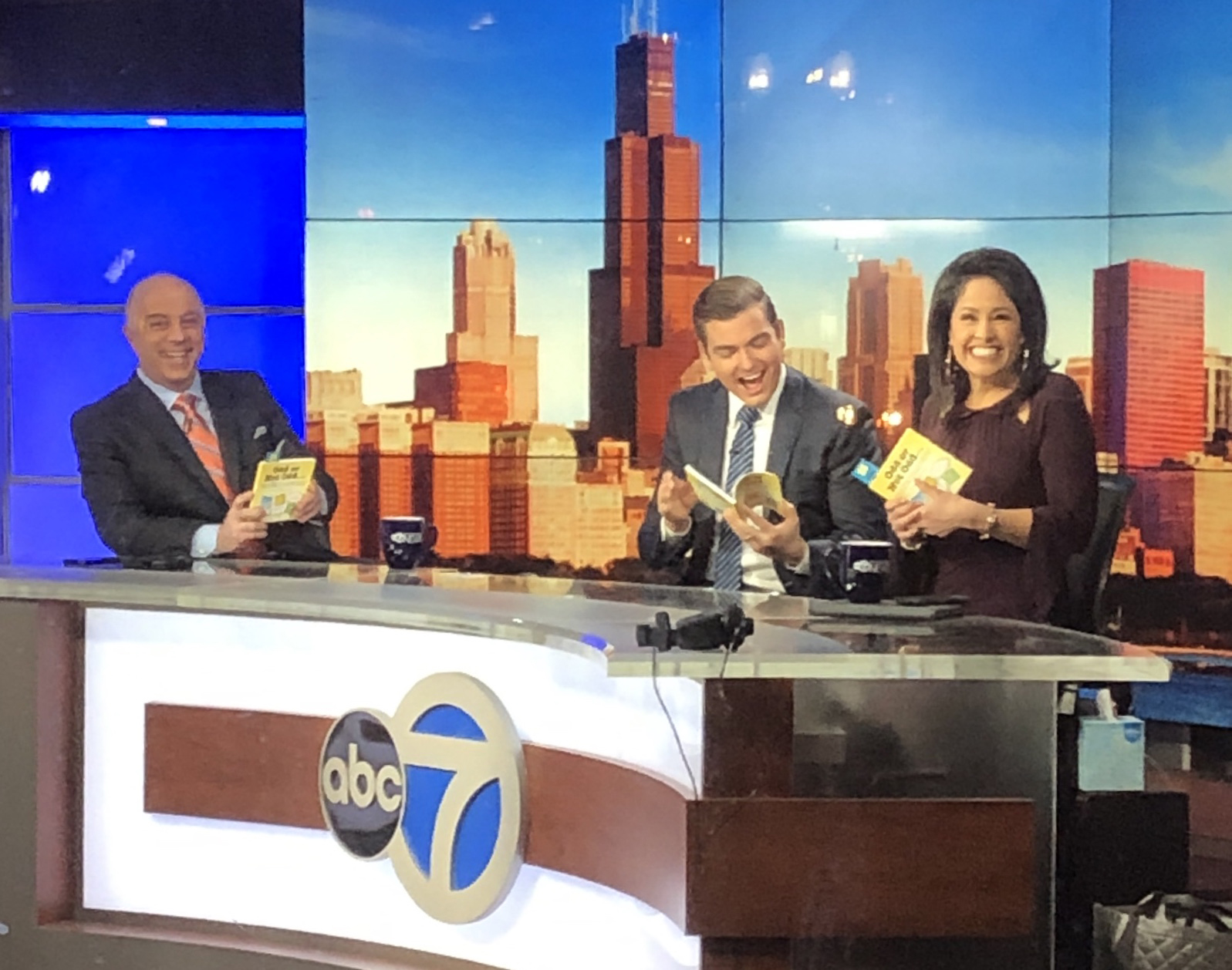 The ABC Channel 7 weekend news team enjoying our book!