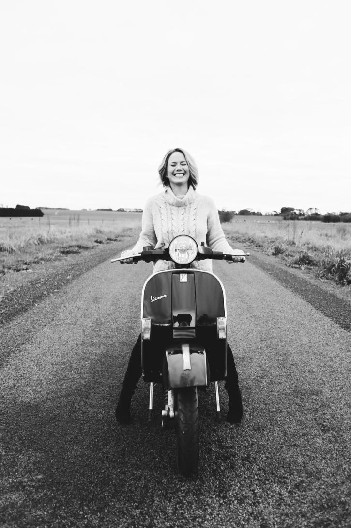 Hayley Carr - Leadership coach riding a vespa