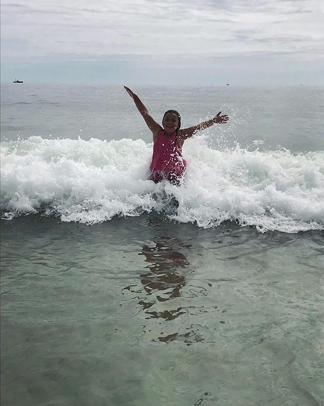 Pure bliss ☀️Isabelle playing in the waves at Fortune's Rocks this morning on one of the last handful of summer rides. Thanks to volunteer, @runjkrun, for the beautiful shot! #getkidsoutside #healthykids #youthdevelopment #mainebeaches #joy #mainekids