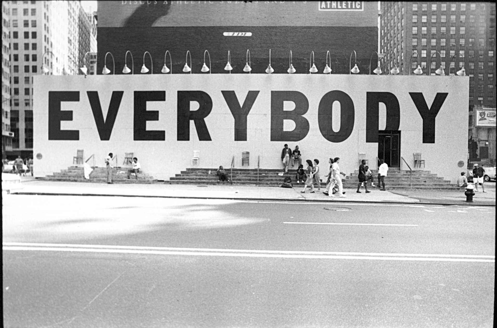 """The famous """"Everybody"""" billboard, designed by Tibor Kalman, that the 42nd Street Development project commissioned with Creative Time to bring people back to the block once the stores and buildings had been condemned. Credit: Maggie Hopp for Creative Time"""