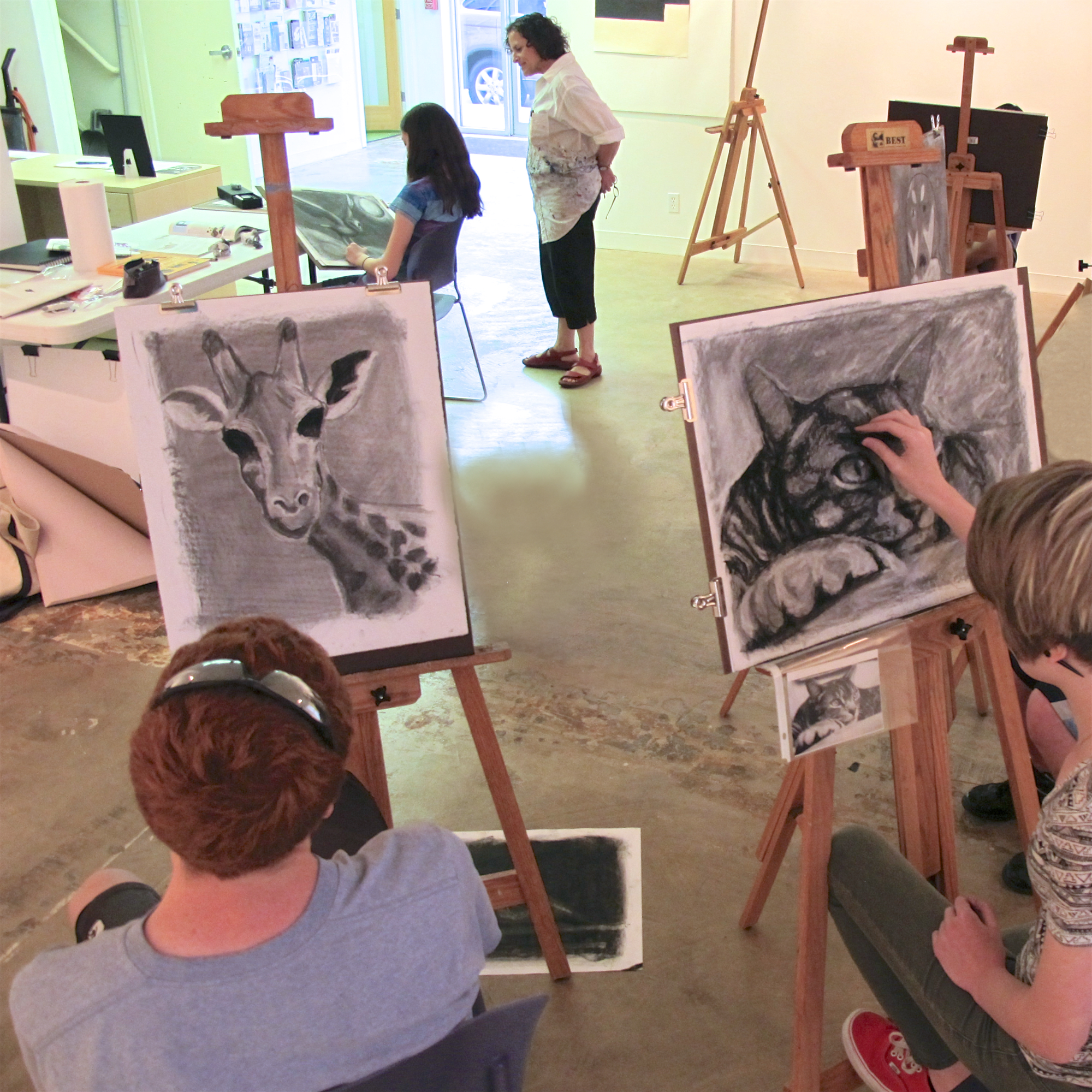 "August 2011 - Leona teaches a class of high school students a workshop on ""How to Draw Animals."""
