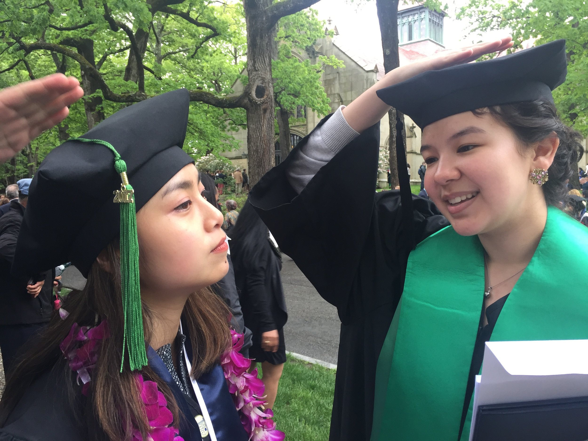 Willow and I debating the proper way to wear the tam, aka the funny graduation hats