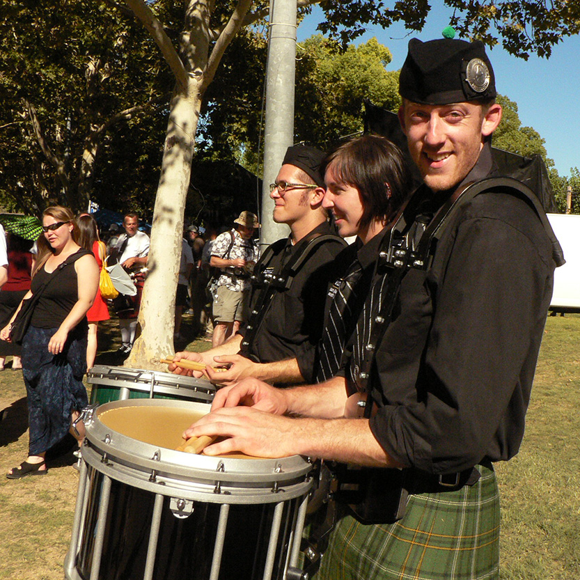 I played drums in a bagpipe band for six years, and yes we wore kilts