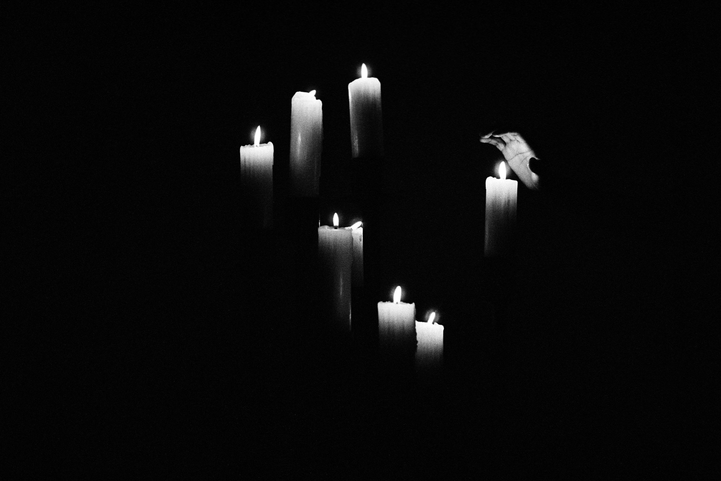 Candles, hand