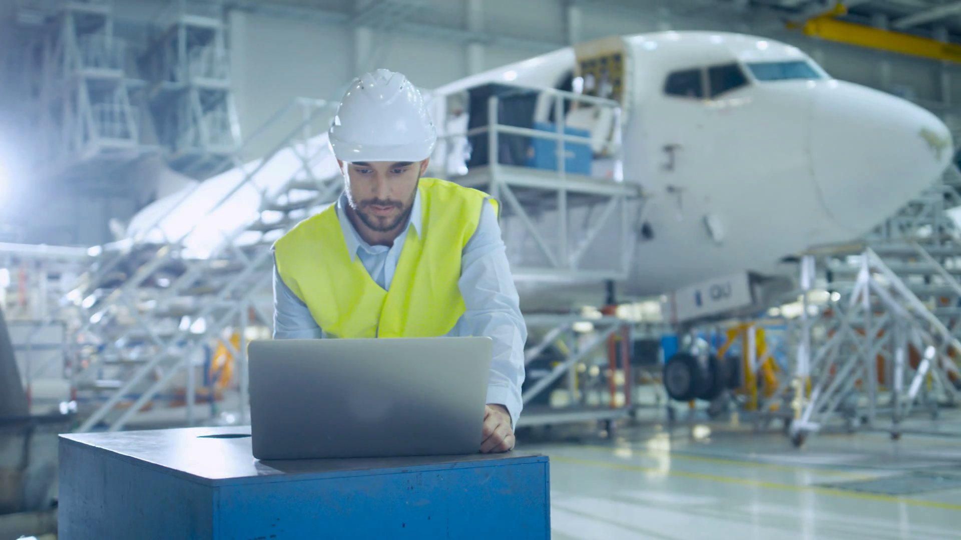 16_77_35_engineer_in_safety_vest_next_to_computer_in_aircraft_maintenance_t_sq-o3ler_thumbnail-full01.png