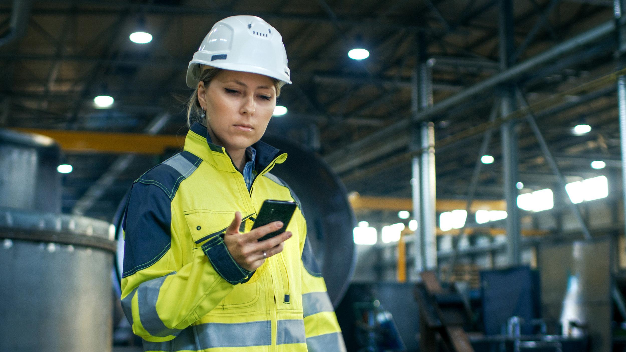 Female Engineer on Phone in Factory.jpg