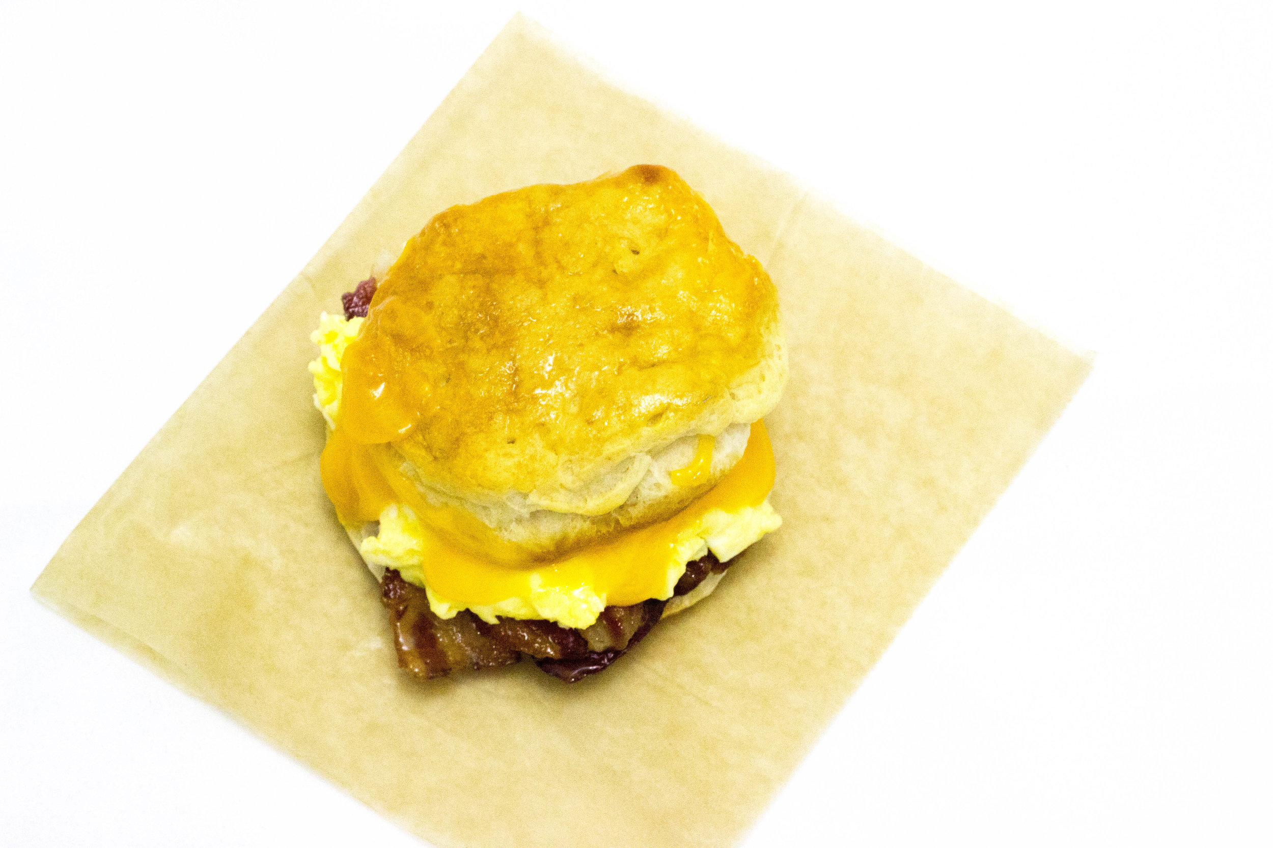 biscuit breakfast sandwich : bacon, egg, and cheese, with jalapeño aioli