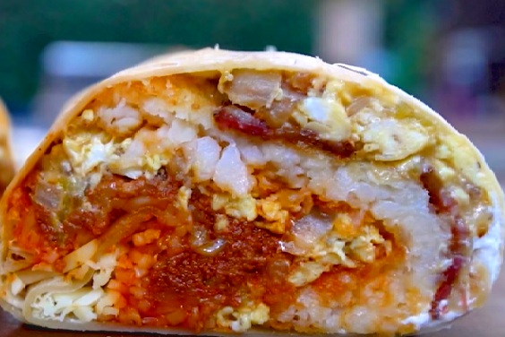 Loaded Breakfast Burrito - Flour tortilla packed with egg, chorizo, bacon, monterey jack cheese, crispy hash browns and sour cream