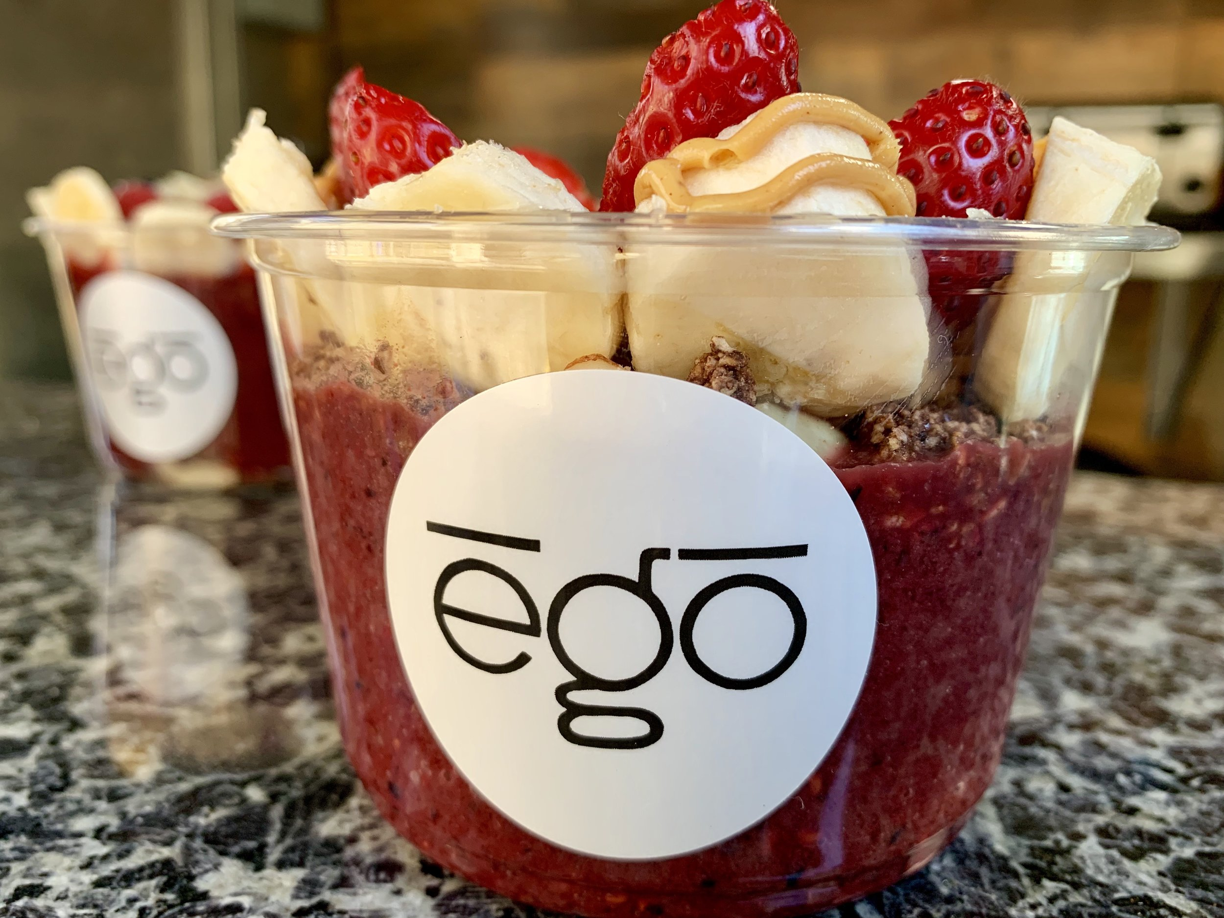 Açaí Bowl - Tambor Organic Açaí blended with bananas, berries and your choice of toppings: coconut, homemade granola, strawberries, honey, almond, chia seed, nutella, peanut butter