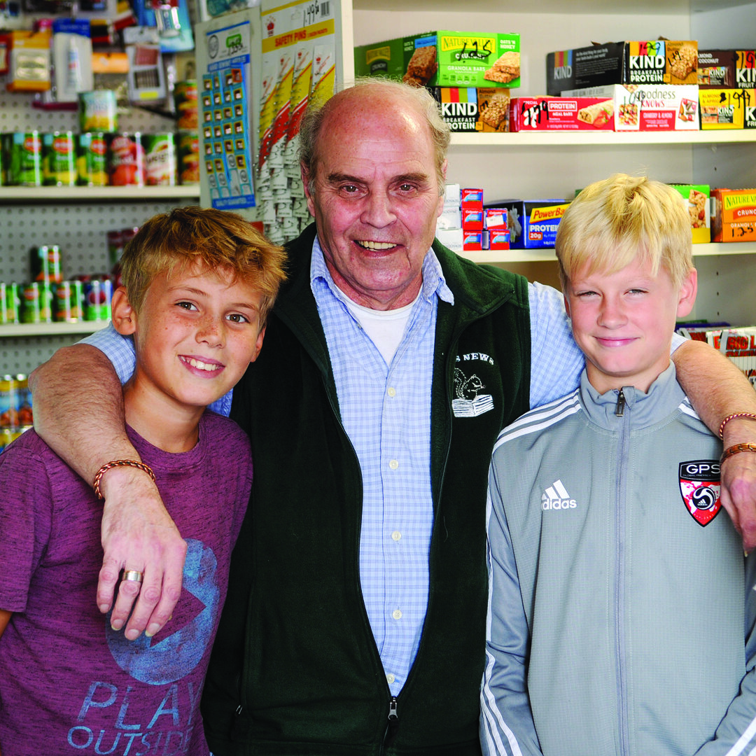 Tom with loyal customers Leo Fowler (left) and Maclan Griscom (right).