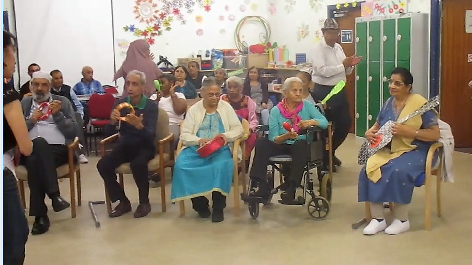 - Service Users enjoying a music session playing instruments