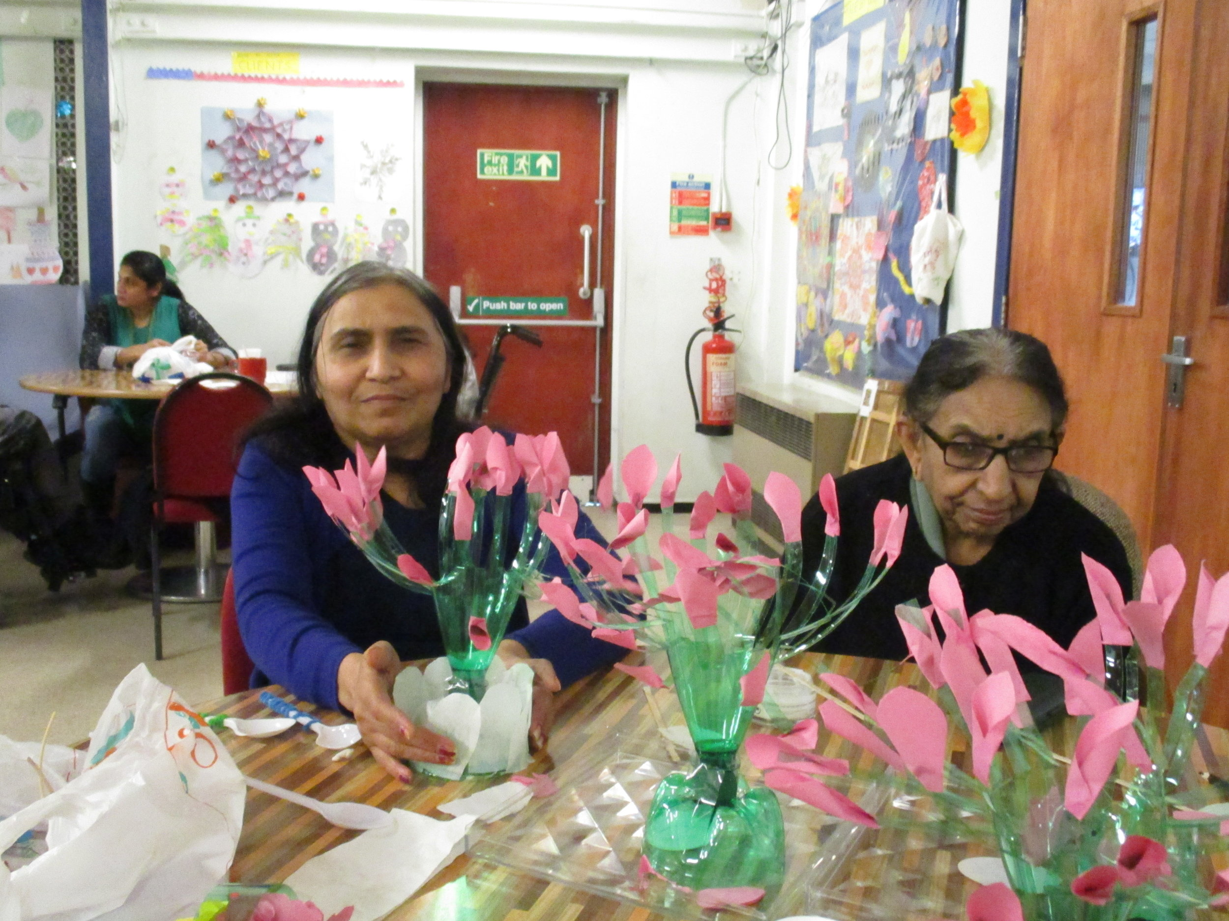 Service Users making flowers out of recycled bottles