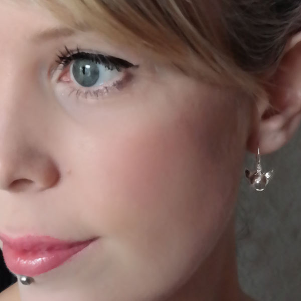 Silver tiny crash helment earrings